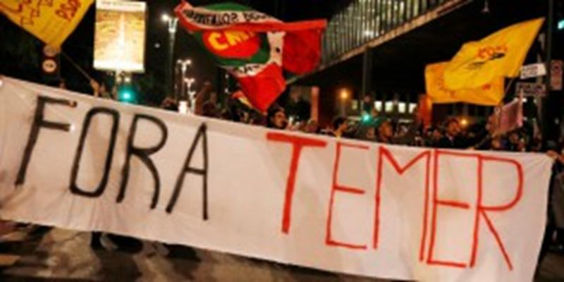 """Demonstrators protest against Brazil's President Michel Temer in Sao Paulo, Brazil, May 17, 2017. The banner reads: """"Out Temer."""" REUTERS/Nacho Doce"""