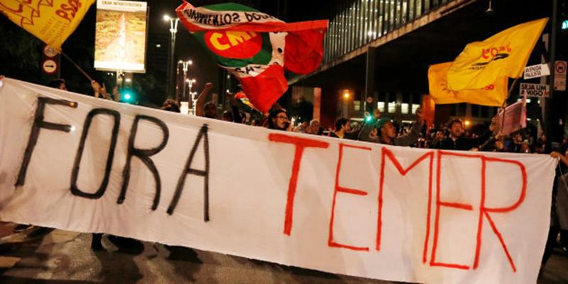 "Demonstrators protest against Brazil's President Michel Temer in Sao Paulo, Brazil, May 17, 2017. The banner reads: ""Out Temer.""  REUTERS/Nacho Doce"